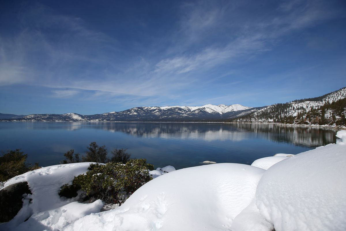Snow covers the Sierra Nevada mountains and the shoreline of Lake Tahoe on Monday, Jan. 30, 2017, near Memorial Point, Nevada. (Aric Crabb/Bay Area News Group)