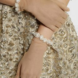 <b>6. Simone Rocha Faux Pearl-Embellished Tulle Gloves,</b> $745: These faux pearl-embellished tulle gloves were one of the key accessories from Simone Rocha's Spring '14 runway show. Not as ornate as some of the other gloves featured, they make a great i