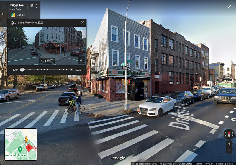 A person has a bicycle on a street in Brooklyn, which is recorded by Google's Street View