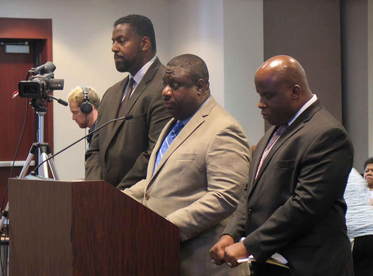 Marcus Robinson, CEO of Tindley Schools, (center) addresses the Indiana State Board of Education in 2014.
