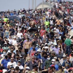 Spectators walk from their vantage point on a bridge in Titusville, Fla. after watching SpaceX Falcon 9 lift off with NASA astronauts Doug Hurley and Bob Behnken in the Dragon crew capsule, Saturday, May 30, 2020 from the Kennedy Space Center at Cape Canaveral, Fla.