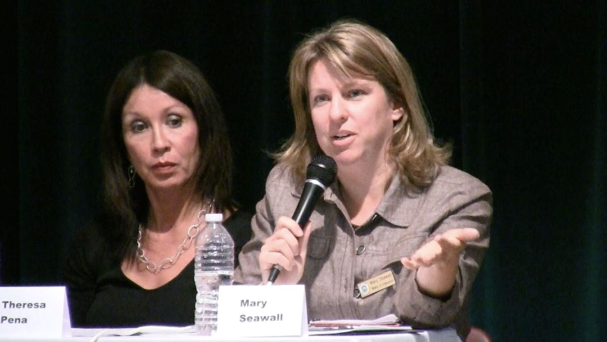 DPS board member Mary Seawell, right, spoke in support of releasing the innovation school funds at the May 13 community meeting.