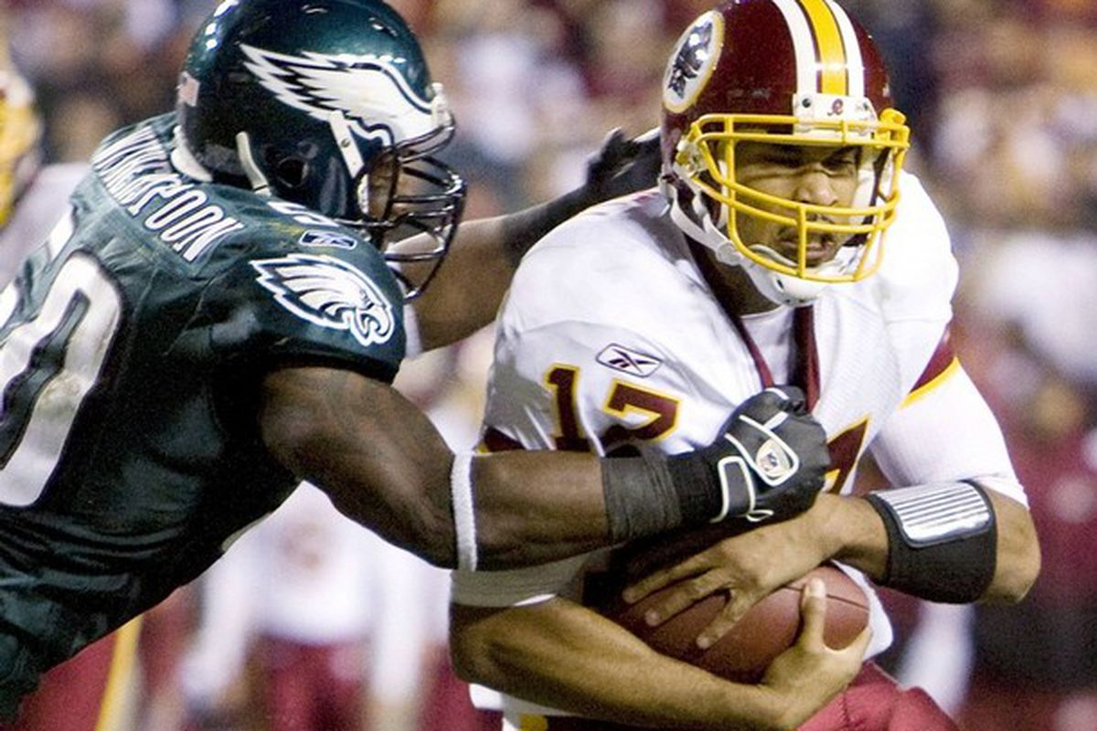 Washington Redskins quarterback Jason Campbell is tackled by former Philadelphia Eagles linebacker Will Witherspoon in the second-half of their NFL football game. (REUTERS/Larry Downing)