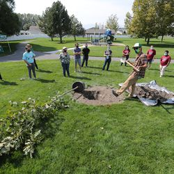 Ian Peisner, arborist and planning coordinator for Tree Utah, gives instructions to volunteers taking part in a Tree Utah community planting event at Sommerset Park in Lehi on Wednesday, Sept. 23, 2020.