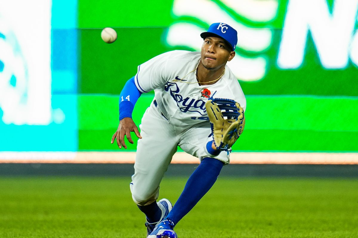 Kansas City Royals right fielder Edward Olivares (14) catches a line drive against the Pittsburgh Pirates during the seventh inning at Kauffman Stadium. Mandatory Credit: Jay Biggerstaff