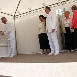 "President Dieter F. Uchtdorf applies mortar to the capstone of the Quetzaltenango Guatemala Temple during Sunday""™s dedicatory activities."