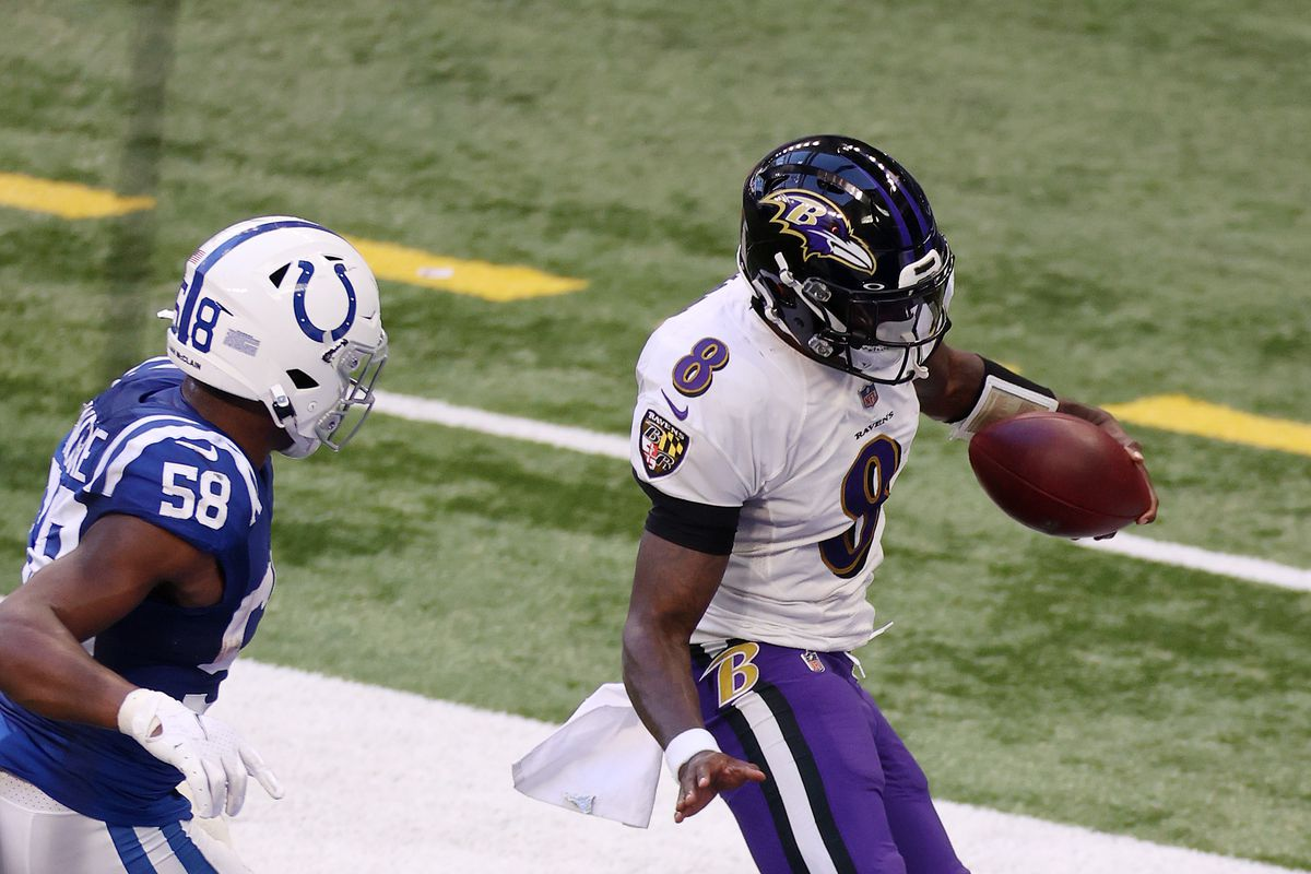 Lamar Jackson #8 of the Baltimore Ravens runs for a touchdown against Bobby Okereke #58 of the Indianapolis Colts during the second half at Lucas Oil Stadium on November 08, 2020 in Indianapolis, Indiana.