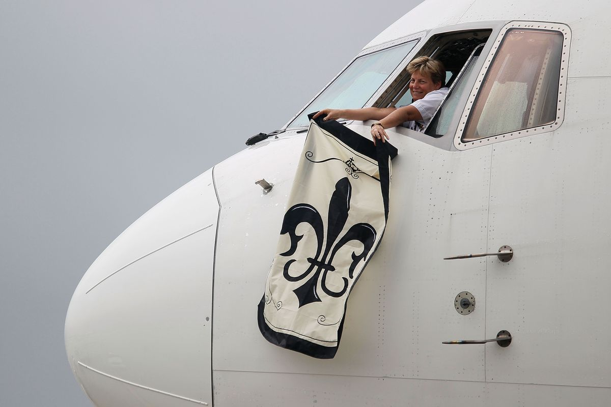 MIAMI - A Delta Airlines pilot waves a Saints flag after  landing with members of the New Orleans Saints at Miami International  Airport prior to the start of Super Bowl XLIV.