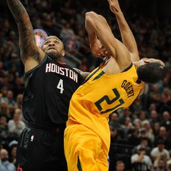 Houston Rockets forward PJ Tucker (4) drives through Utah Jazz center Rudy Gobert (27), elbowing him in the face in the process, as the Utah Jazz host the Houston Rockets at Vivint Smart Home Arena in Salt Lake City on Thursday, Dec. 7, 2017.