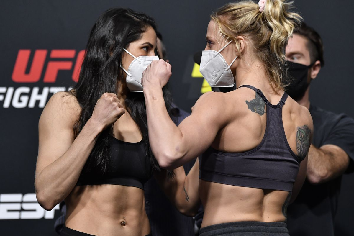 Opponents Polyana Viana of Brazil and Emily Whitmire face off during the UFC Fight Night weigh-in at UFC APEX on August 28, 2020 in Las Vegas, Nevada.