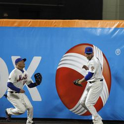 An RBI double by Washington Nationals' Wilson Ramos bounces above the head of New York Mets right fielder Lucas Duda, who can't locate it, as center fielder Scott Hairston comes in to assist Duda during the sixth inning of a baseball game in New York, Tuesday, April 10, 2012.