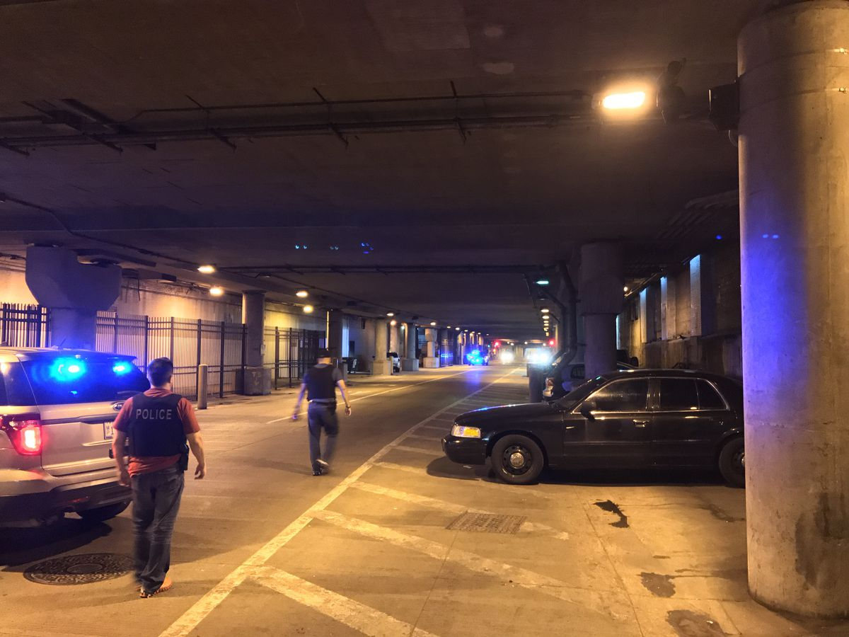 Police investigate after a man was shot on Monday afternoon along Lower Wacker Drive near Garland Court underneath the Loop. | Mitch Armentrout/Sun-Times