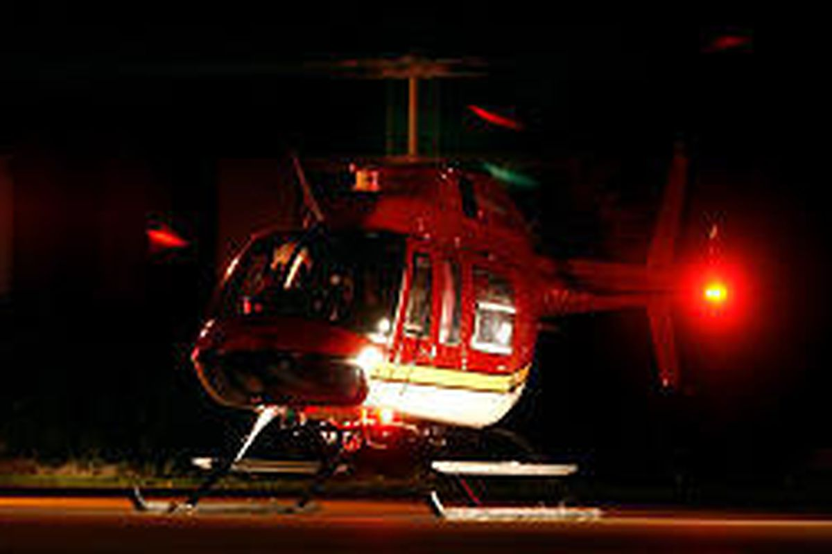 A medical helicopter prepares to lift off with child who was injured in an auto-pedestrian accident in Taylorsville.<BR>