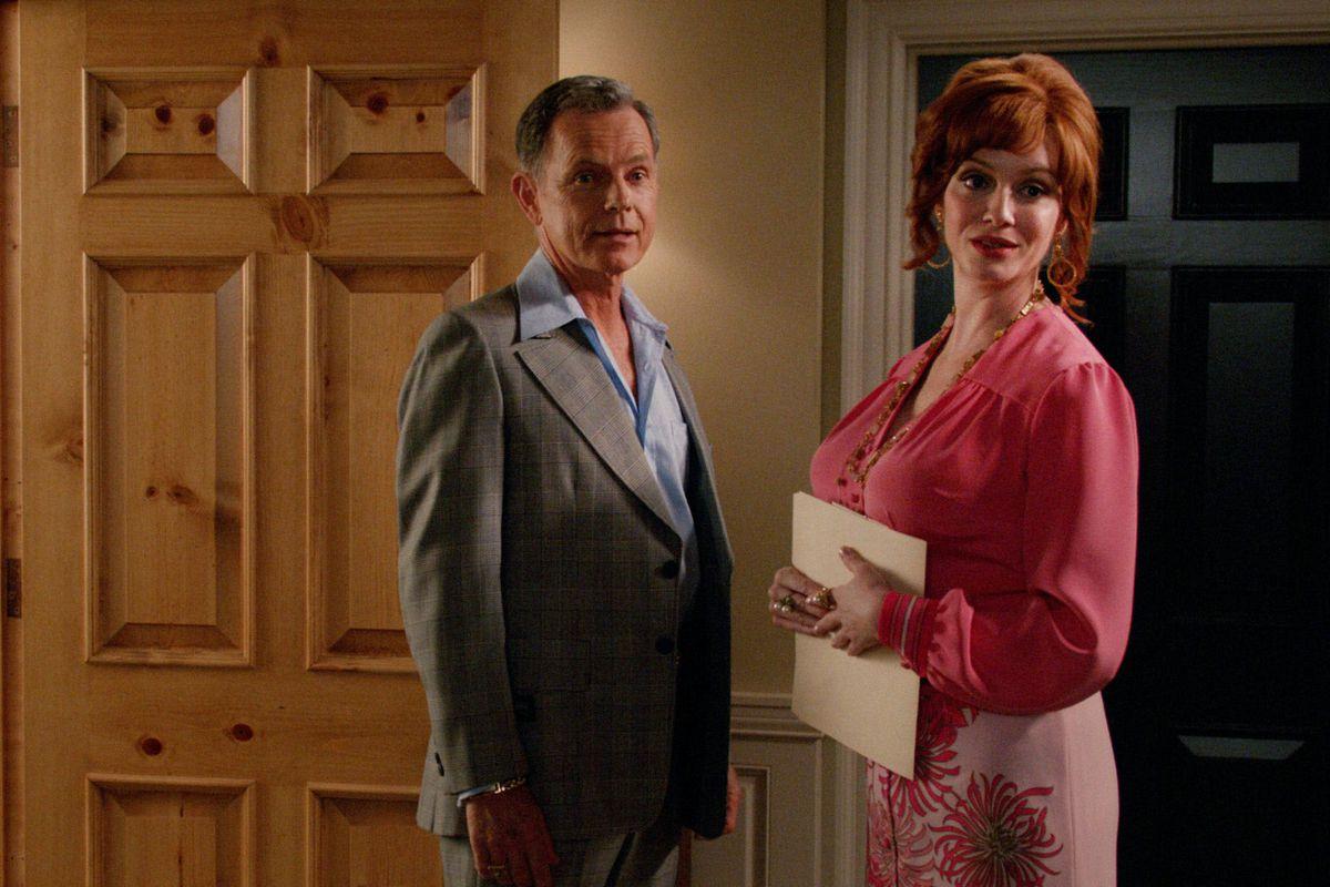 Richard (Bruce Greenwood) and Joan (Christina Hendricks) share a quick moment together.