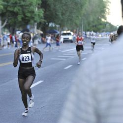 Atalelech Asfaw runs the Deseret News 10K race that started in Research Park and ended in Liberty Park in Salt Lake City Saturday.