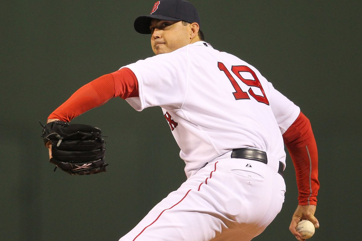 BOSTON, MA - APRIL 10: Josh Beckett #19 of the Boston Red Sox throws against the New York Yankees at Fenway Park April 10, 2011 in Boston, Massachusetts. (Photo by Jim Rogash/Getty Images)