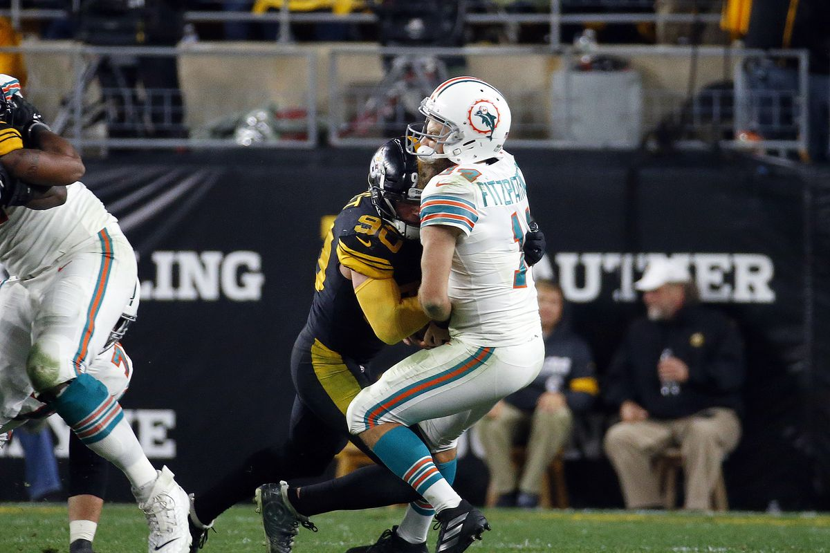 T.J. Watt of the Pittsburgh Steelers strip sacks Ryan Fitzpatrick of the Miami Dolphins in the second half on October 28, 2019 at Heinz Field in Pittsburgh, Pennsylvania.