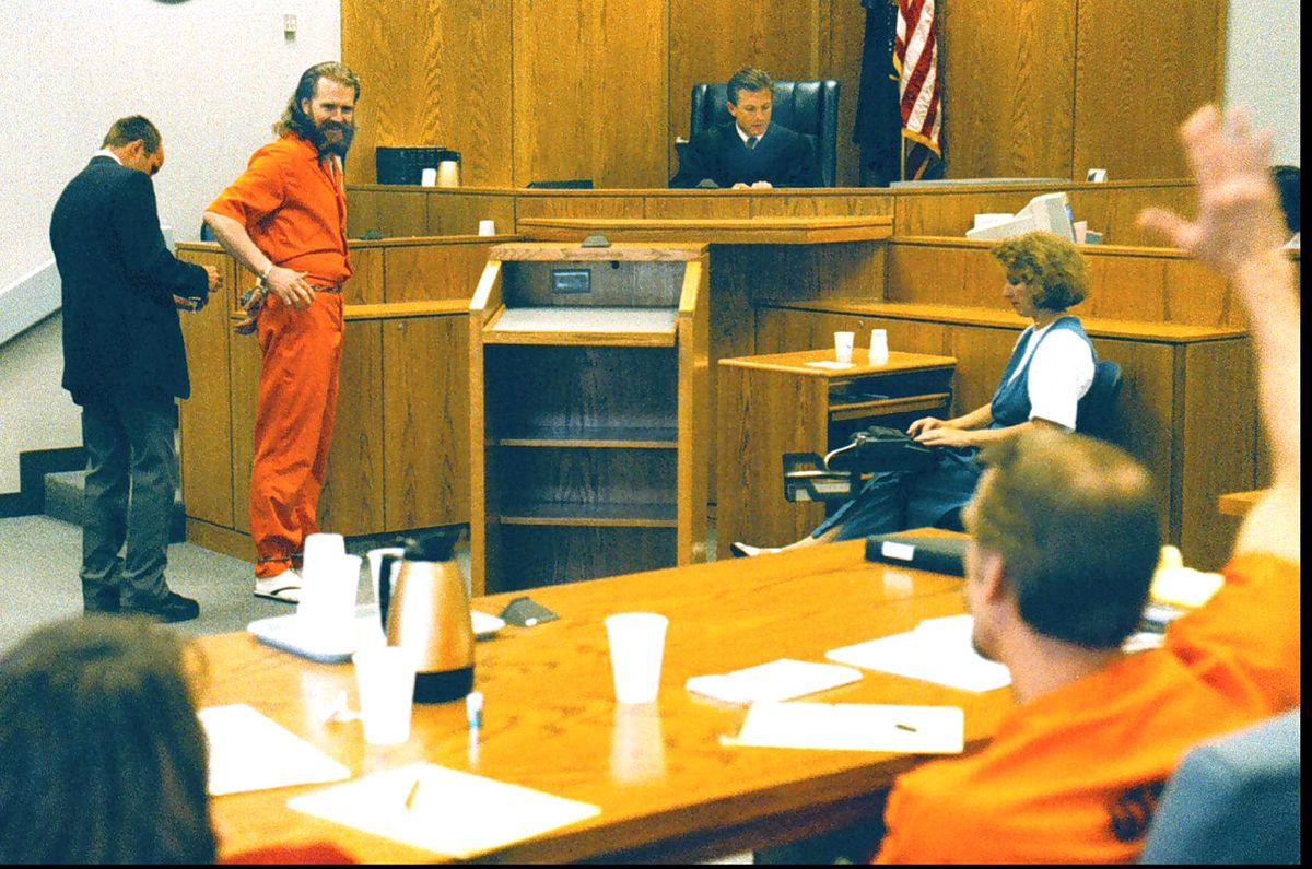 Dan Lafferty smiles at brother Ron as Ron waves to Dan in the mid-1990s. The Lafferty's had not seen each other for 11 years after being convicted in 1985 for the murder of their sister-in-law and baby niece.