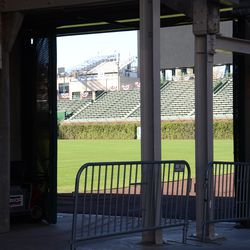 Sat 3:33 p.m. The only view of inside the ballpark from the street, at Gate R -