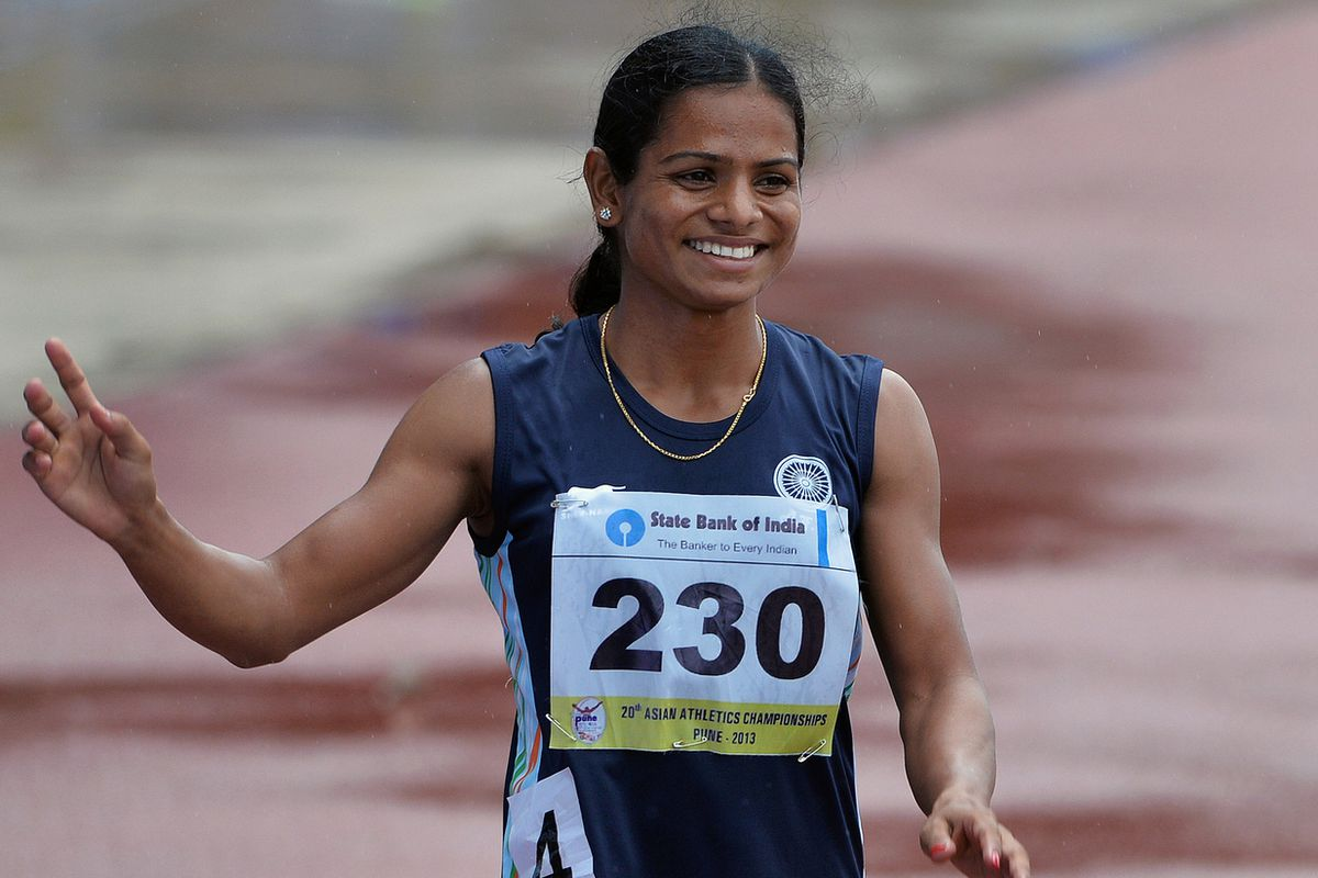 Women's 200 meters bronze medal winner from India Dutee Chand waves to the crowd after her race on the fifth and the final day of the Asian Athletics Championship 2013 at the Chatrapati Shivaji Stadium.