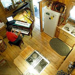 Kurt Bestor composes music in a cabin he rented above Sundance. Bestor spent the month of August writing and composing music for a new CD.
