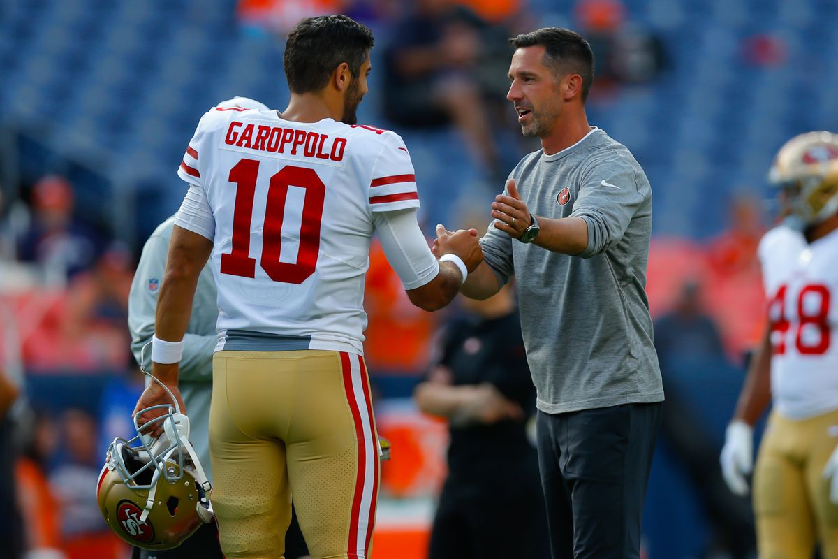 Quarterback Jimmy Garoppolo and head coach Kyle Shanahan of the San Francisco 49ers shake hands before a preseason game against the Denver Broncos at Broncos Stadium at Mile High on August 19, 2019 in Denver, Colorado.