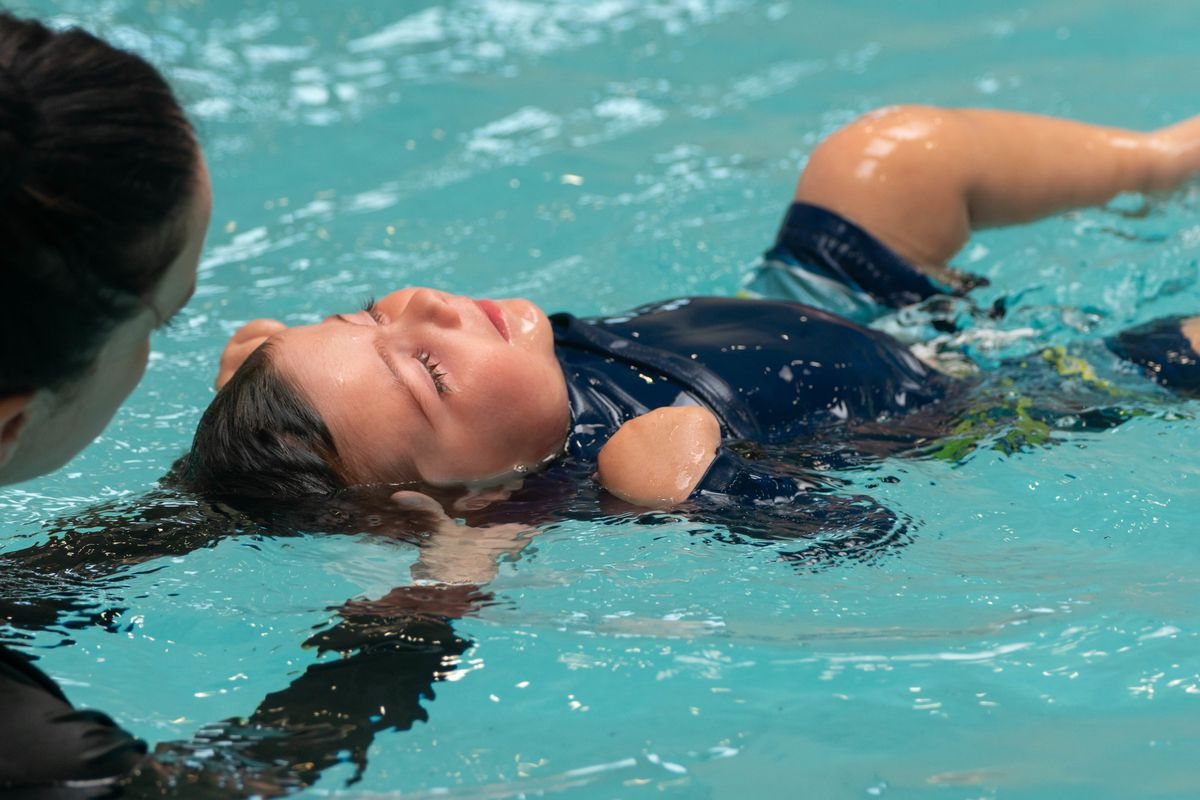Dominic Altobelli, 14 months old, gets an individualized back float lesson at CAST Water Safety Foundation's pool in Forest Park.