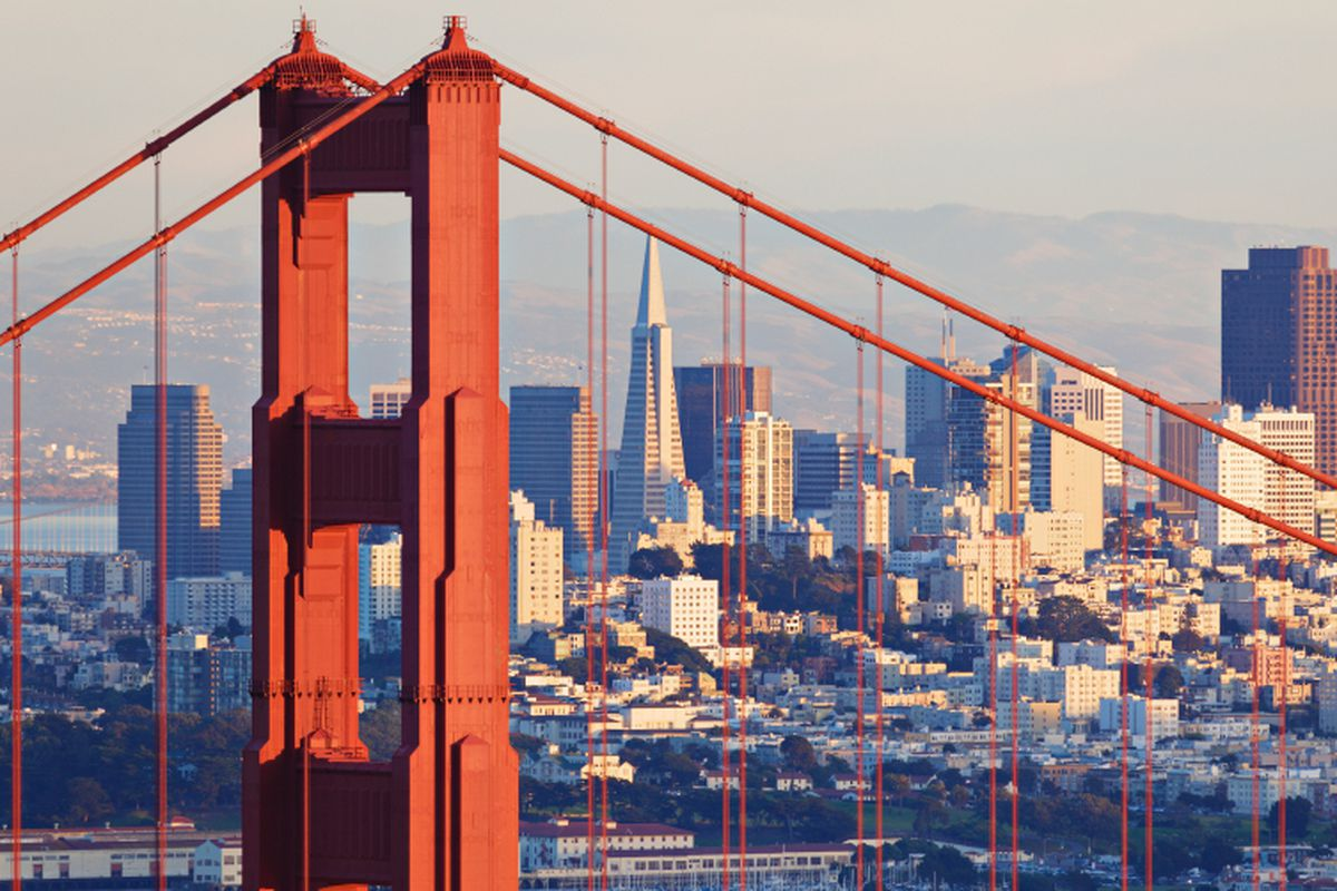A view of downtown San Francisco seen through one of the towers of the Golden Gate Bridge.