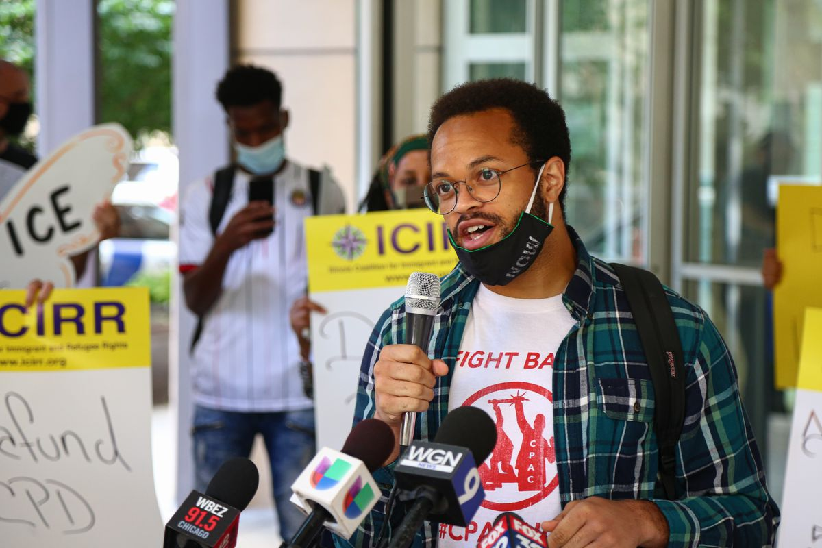 Kobi Guillory, with the Chicago Alliance Against Racist and Political Repression, speaks with the media during a protest outside the Immigration and Customs Enforcement office at 101 W. Ida B. Wells Dr in South Loop, Tuesday, Aug. 4, 2020.