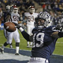 Brigham Young wide receiver Matt Marshall (19) celebrates after scoring a touchdown during the Cougars' win over New Mexico State.