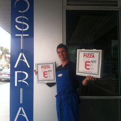 Hostaria del Piccolo's Christian Bertolini poses with an Eater pizza box.