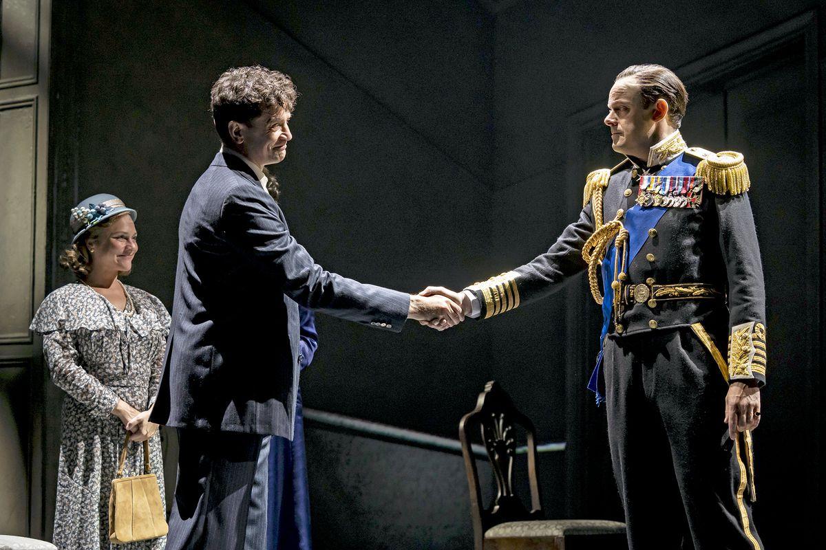"Bertie (HarryHadden-Paton, right) expresses his gratitude for speech therapist LionelLogue (JamesFrain), as MyrtleLogue (ElizabethLedo) proudly looks on in ""TheKing'sSpeech."""