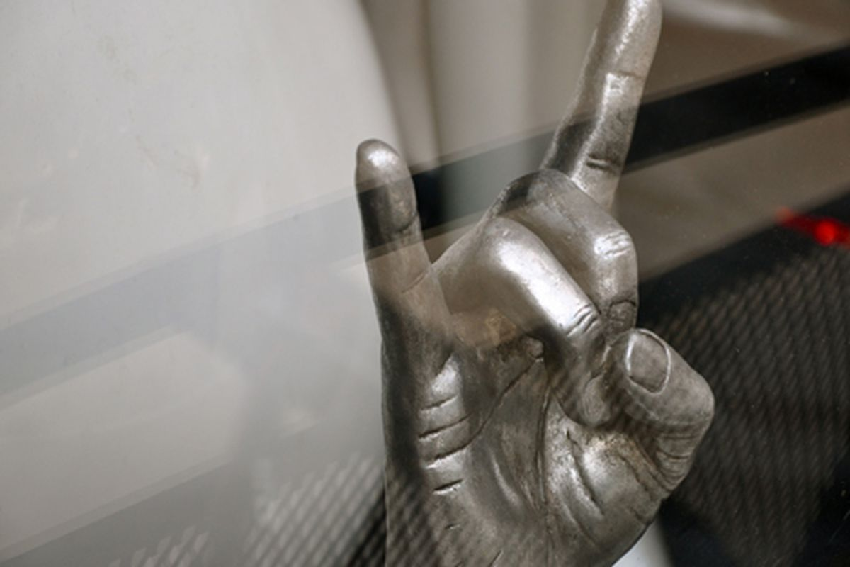 """Rock hand in an LES boutique window via <a href=""""http://www.flickr.com/photos/essgee/4513177146/in/pool-312691@N20"""">EssG</a>/Racked Flickr Pool"""