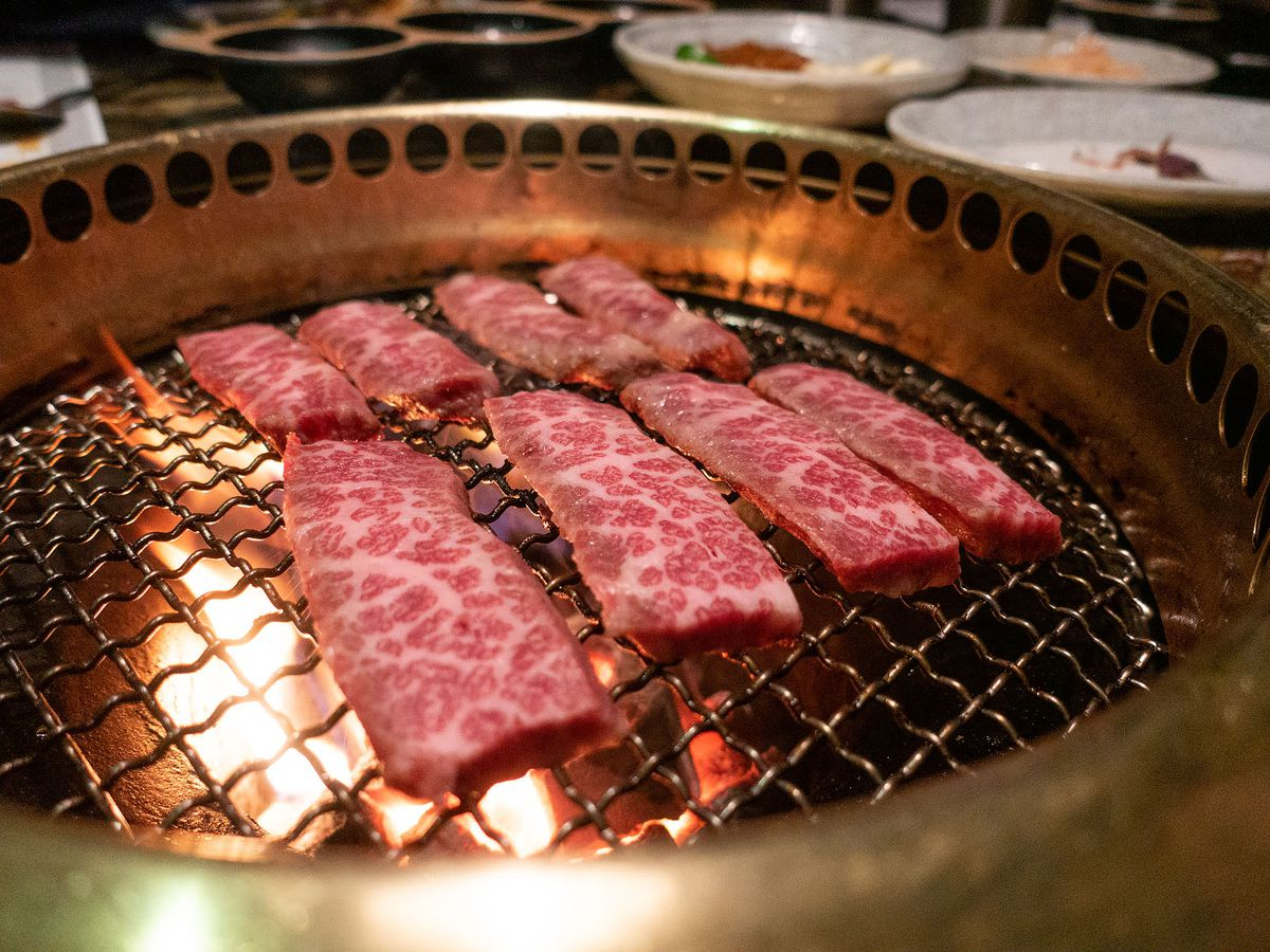 Grilling beef at Jeong Yuk Jeom