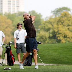 Mount Carmel assistant golg coach Jordan Lynch looks on after teeing off during practice at Jackson Park Golf Course.