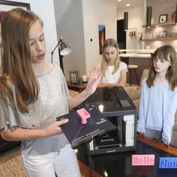Ella, left, Sofia and Anna Gelston, daughters of L3Harris President Dan Gelston, talk about how they used a 3D printer to make a part for positive air pressure respirators at their home in Park City on Friday, April 24, 2020. Over 100 L3Harris engineers and employees assembled 1,200 positive air pressure respirators to donate to the University of Utah Health to protect medical first responders during the coronavirus pandemic.