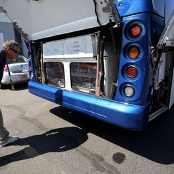 Troy Fillerup checks out a model bus outside the Utah Transit Authority offices in Salt Lake City on Tuesday, Aug. 2, 2016. The bus is similar to five new zero-emission battery-electric buses from New Flyer that will be used in Salt Lake City. The Utah Transit Authority has received a $5.4 million low- or no-emission vehicle deployment grant from the Federal Transit Administration.