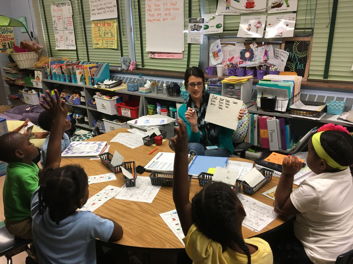 A teacher works with students at a Chattanooga elementary school.