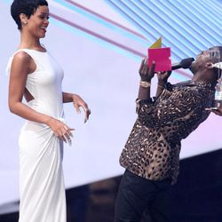 """Kevin Hart, right, presents the award for video of the year to Rihanna for """"We Found Love"""" at the MTV Video Music Awards on Thursday, Sept. 6, 2012, in Los Angeles."""