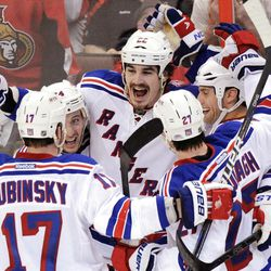 New York Rangers' Brian Boyle, center, celebrates his goal during the third period of Monday night's game.