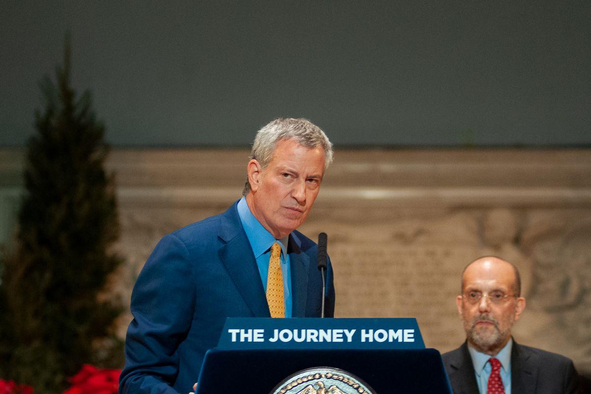 Mayor Bill de Blasio touts a plan at Judson Memorial Church to end street homelessness, Dec. 17, 2019.