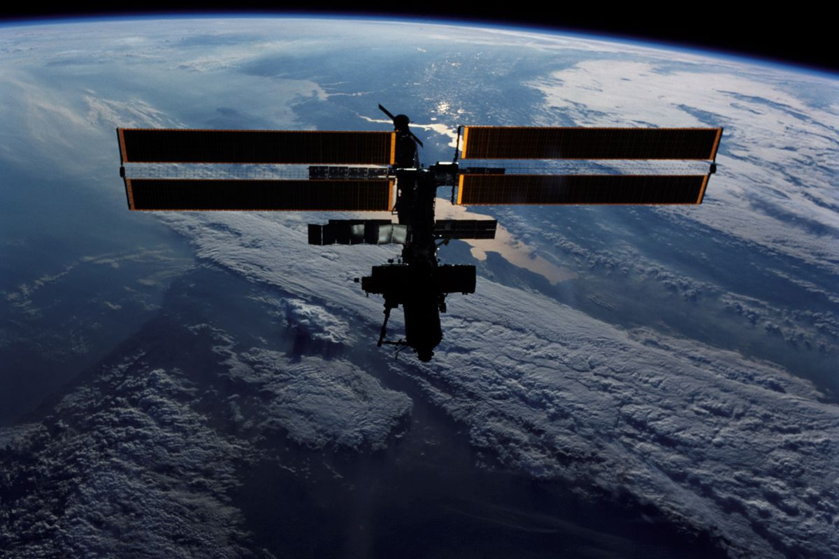 A View Of The International Space Station Silhouetted Over Earth Taken By Crewmember On Board Shuttle Endeavour June 15th 2002 Photo NASA