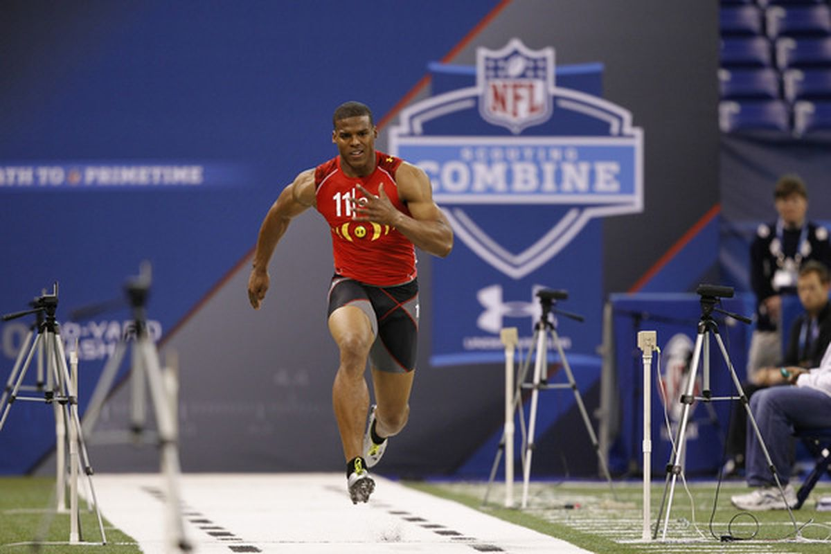INDIANAPOLIS, IN - FEBRUARY 27: Cam Newton runs the 40-yard dash during the 2011 NFL Scouting Combine at Lucas Oil Stadium on February 27, 2011 in Indianapolis, Indiana. (Photo by Joe Robbins/Getty Images)