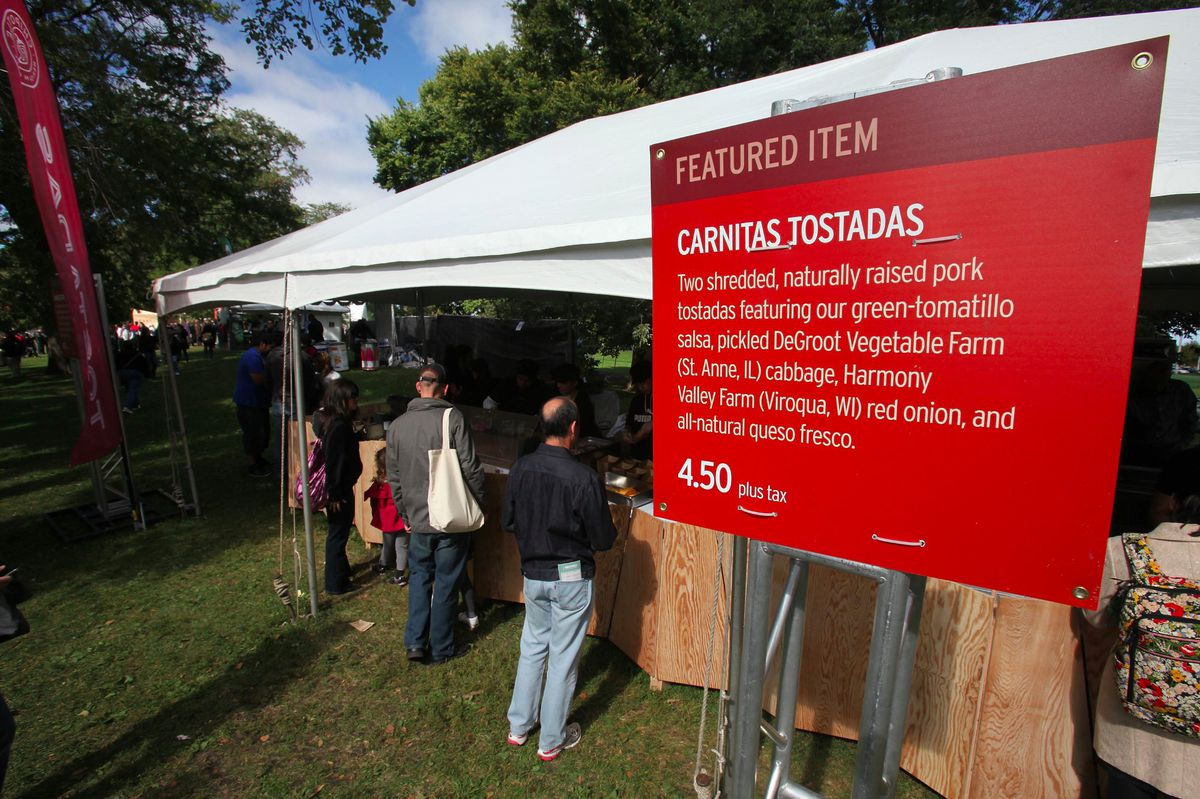 """Signage at Chipotle's Cultivate festival heralds """"TK"""" pork. Photo:"""