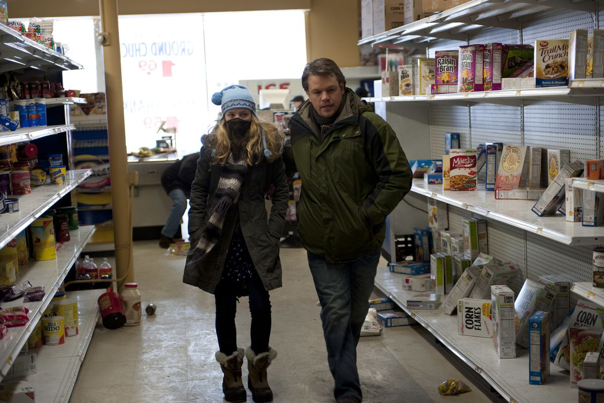 """The daughter (Anna Jacoby-Heron) and husband (Matt Damon) of a virus casualty search for supplies in """"Contagion."""""""