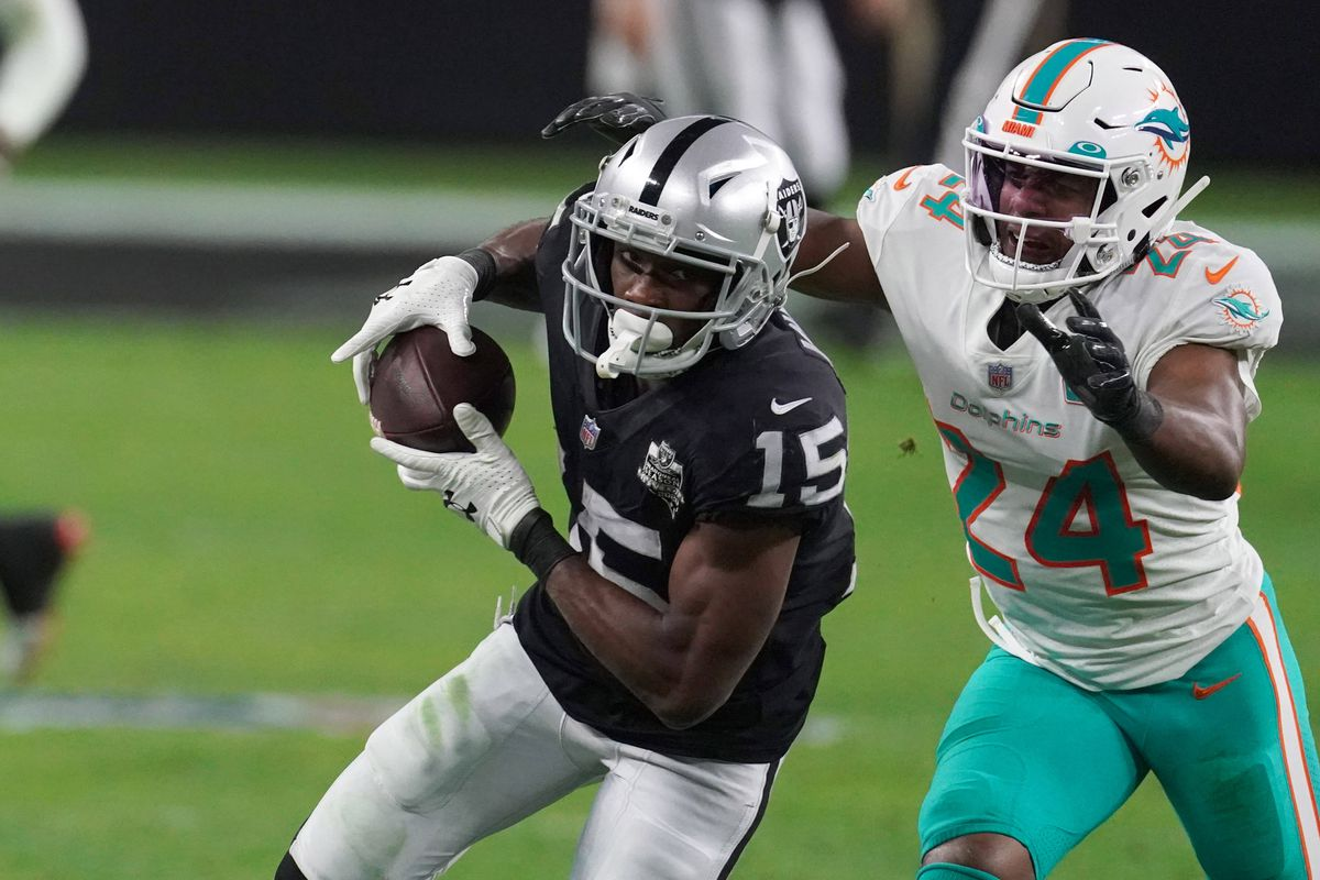 Las Vegas Raiders wide receiver Nelson Agholor (15) is defended by Miami Dolphins cornerback Byron Jones (24) on an 85-yard touchdown reception in the fourth quarter at Allegiant Stadium. The Dolphins defeated the Raiders 26-25.