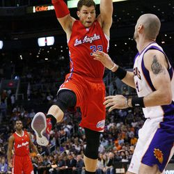 Los Angeles Clippers' Blake Griffin (32) pulls down a rebound over Phoenix Suns' Marcin Gortat, of Poland, during the first half of an NBA basketball game, Thursday, April 19, 2012, in Phoenix.