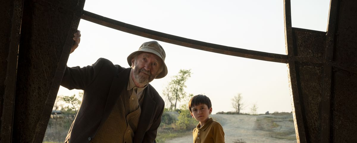 An old man — the director of the mysterious lab at the center of the series — and his grandson stare into the Echo Sphere, which appears to have crashed in a field in Ohio.