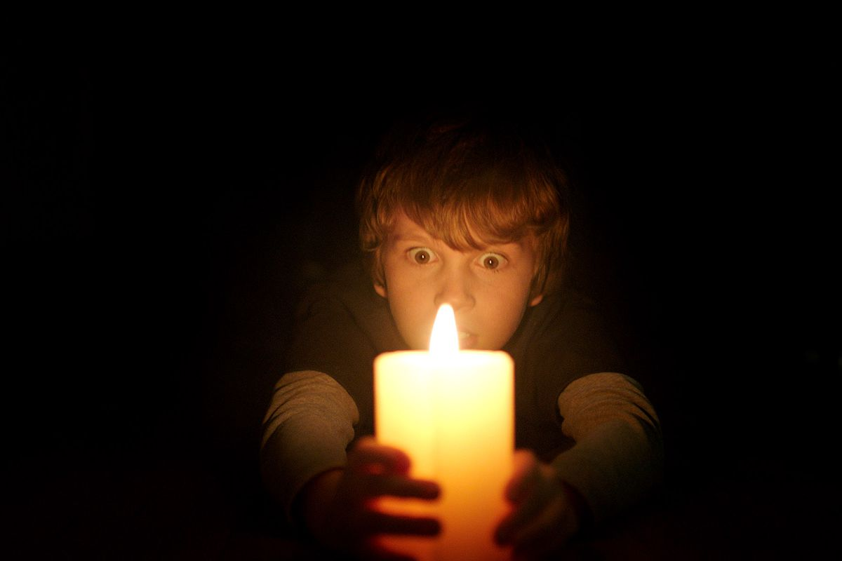 horror lighting. Young Martin Clutches A Candle, The Only Thing Keeping Him From Being Attacked By Vengeful Spirit. Warner Bros. Horror Lighting I