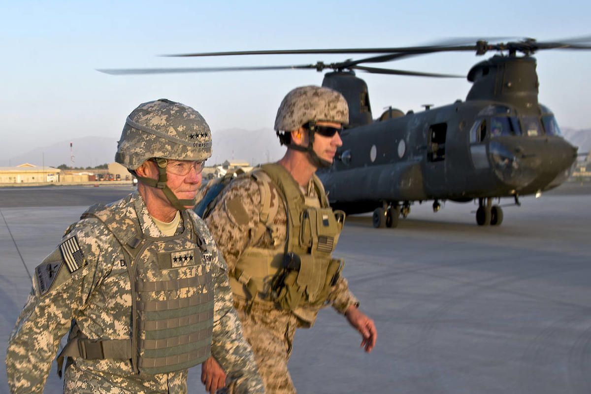 In this image released by the U.S. Department of Defense and taken Monday, Aug. 20, 2012, Army Gen. Martin E. Dempsey, chairman of the Joint Chiefs of Staff, prepares to board a CH-47 at Kabul International Airport in Kabul, Afghanistan. The Defense Depar